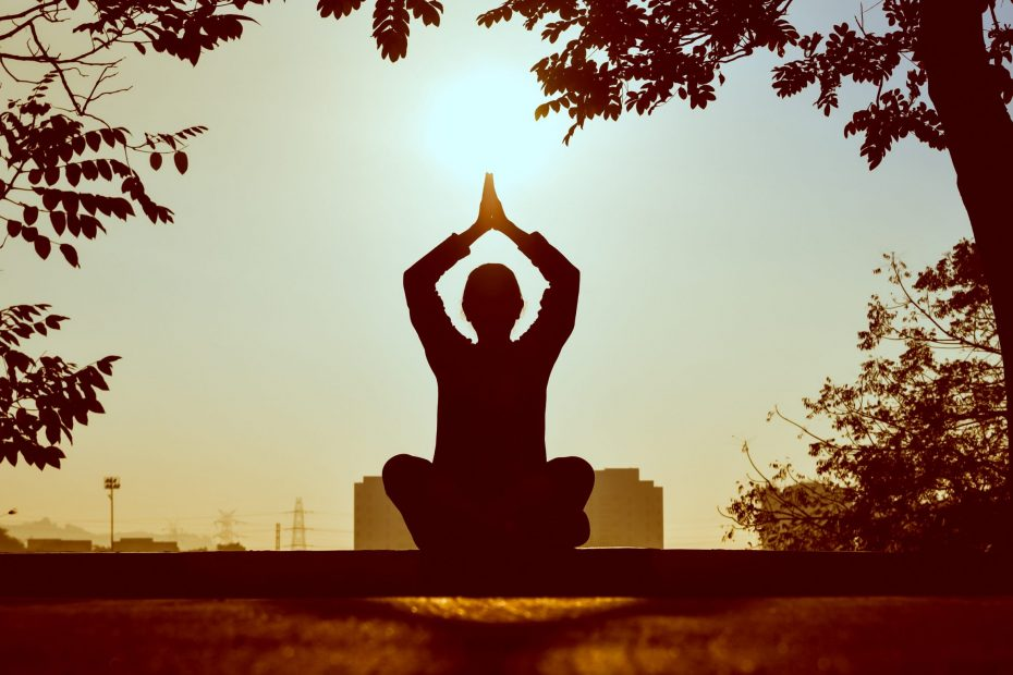 Person doing yoga, practising self-care